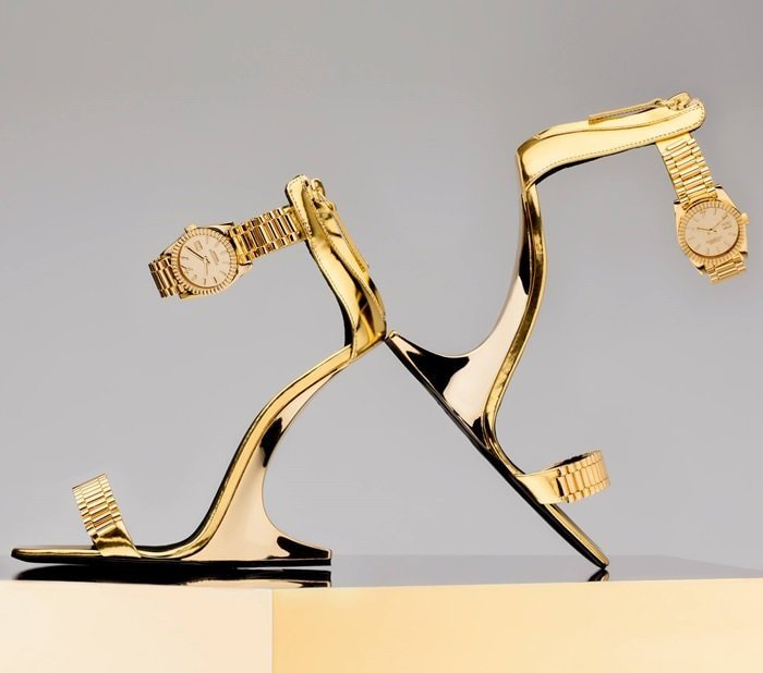 A sensual illusion heel and unexpected wristwatch buckles define this see now-buy now style