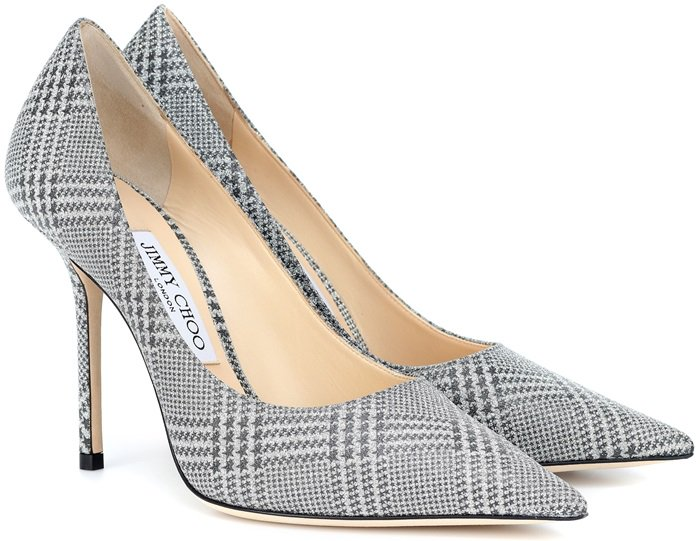 A sharply pointed toe balances the slimmed-down stiletto of an Italian-crafted pump fashioned in shimmering, star-patterned plaid