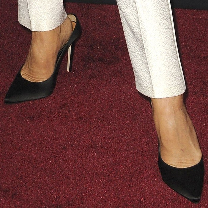 A large gap is evident at the back heel of Victoria Beckham's black satin pumps