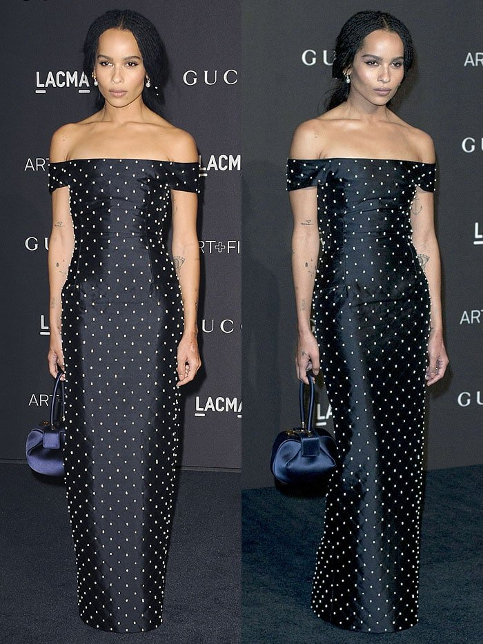Zoe Kravitz wearing a Gabriela Hearst Spring 2019 pearl-embellished navy-satin off-shoulder dress accessorized with a matching Gabriela Hearst 'Demi' bag
