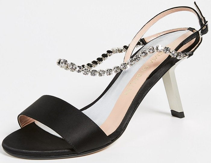 Crafted from silk satin and leather, these embellished sandals feature an open toe, two crystal embellished straps with an adjustable buckle fastening, a high stiletto heel, and a leather sole
