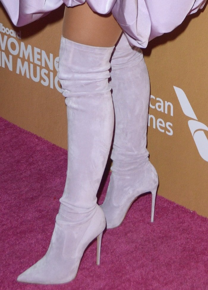 Ariana Grande in suede thigh-high boots from her favorite footwear brand Le Silla