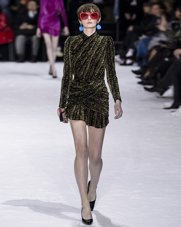 This black and gold mini dress debuted on Balenciaga's AW18 runway
