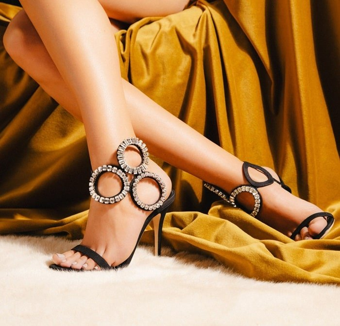 These sandals are made from black mythique fabric