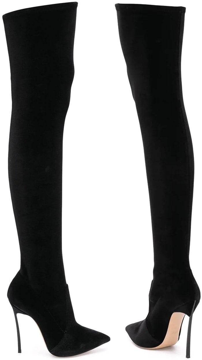 Black velvet and leather pointed over the knee boots from Casadei featuring a pointed toe, over the knee length, a high stiletto heel, a leather insole and a leather sole.