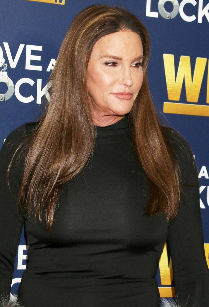 Caitlyn Jenner flaunts her breasts in a figure-hugging black dress