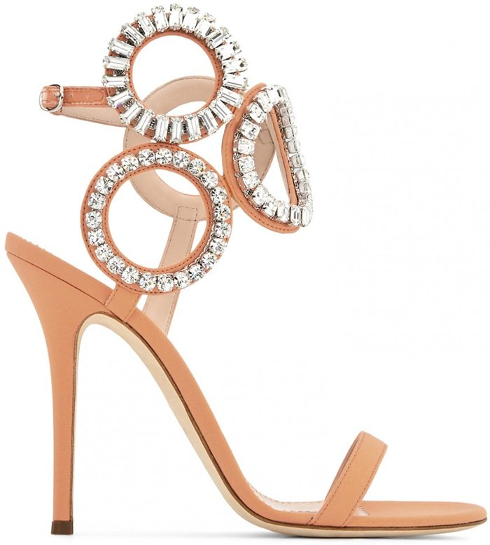 They are set on a stiletto heel and adorned with crystals on the geometric ankle strap