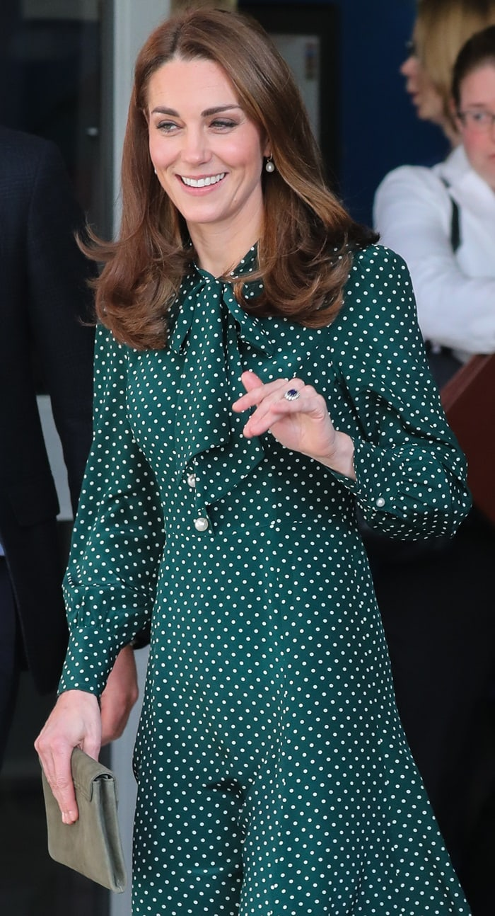 Catherine, Duchess of Cambridge (aka Kate Middleton) totes L.K.Bennett's Dora suede clutch in khaki