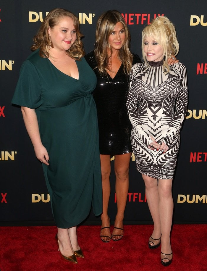 Danielle Macdonald, Jennifer Aniston, and Dolly Parton at the premiere of the Netflix movie Dumplin' held at TCL Chinese 6 Theatresinside Los Angeles' Sunset Tower in Hollywood on December 6, 2018