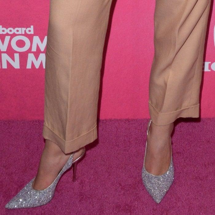 Dua Lipa shows off her feet inplatinum mix painted coarse glitter fabric slingback heels from Jimmy Choo