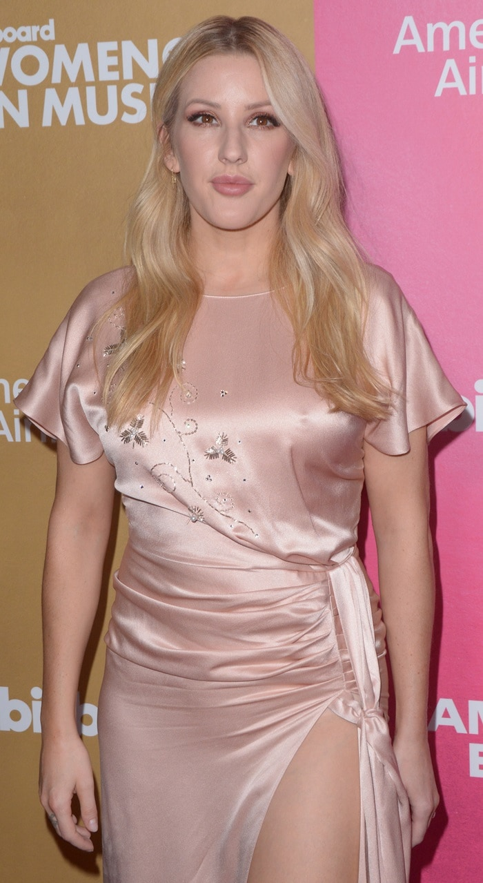 Ellie Goulding's signature golden locks were styled with a middle parting in charming waves at the 2018 Billboard's Women in Music Event at Pier 36 in New York City on December 6, 2018