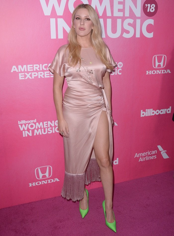 Ellie Goulding flaunts her sexy legs in a silky high-slit statement dress with a dramatic side-knot accent from Polish designer Magda Butrym