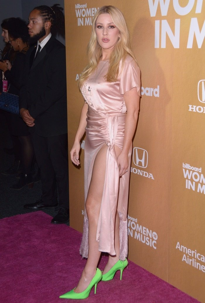 Ellie Goulding's blush pink silky high-slit statement dress with a dramatic side-knot accent