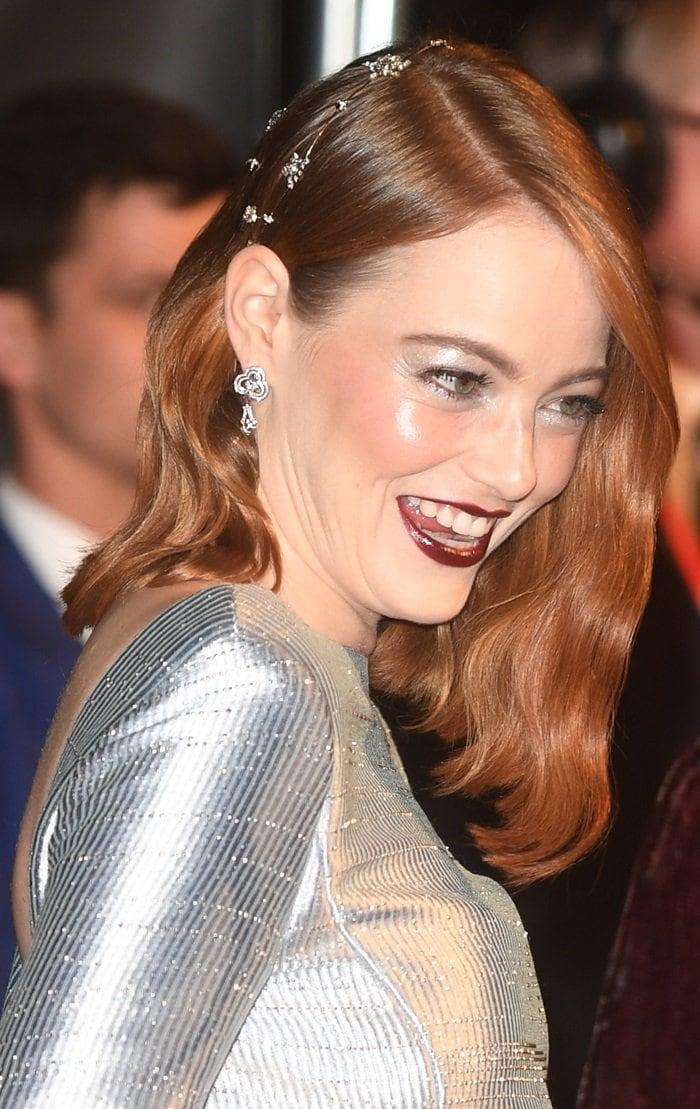Emma Stone witha dramatic deep burgundy lip and silver eyeshadow