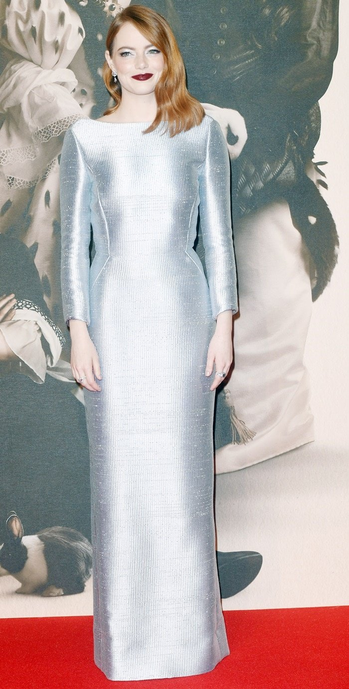 Emma Stone in a custom floor-length silverLouis Vuitton gown atthe UK premiere of her anticipated film The Favourite held during the American Express Gala at the 2018 BFI London Film Festival in London, England, on October 18, 2018