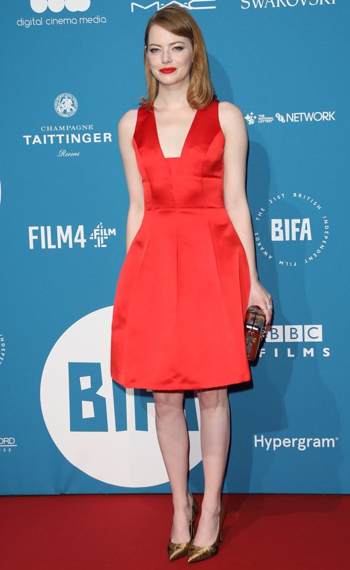 Emma Stone flaunts her sexy legsin a red structured mini dress from theLouis Vuitton Resort 2019 Collection