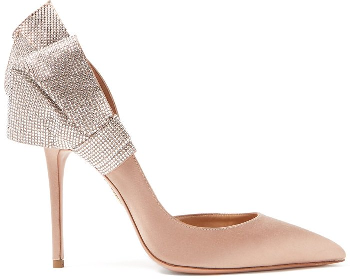 These sexy shoes are Italian-crafted to a slender point-toe silhouette that's adorned with a dazzling crystal-embellished bow that fans out at the heel