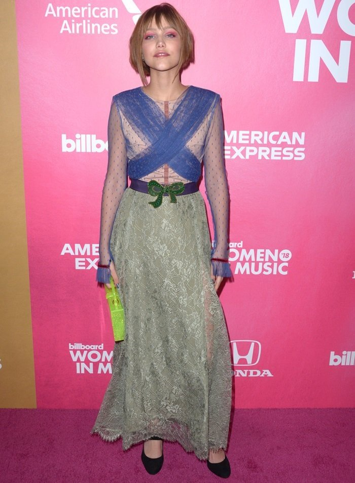 Grace VanderWaal in a blue and green sheer lace dress from Lei Lou by Alex Dojčinović