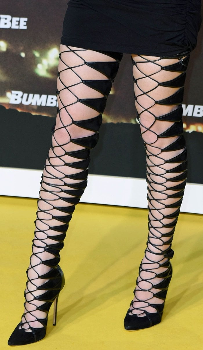 Hailee Steinfeld flaunts her incredible legs in dominatrix-inspired stiletto boots