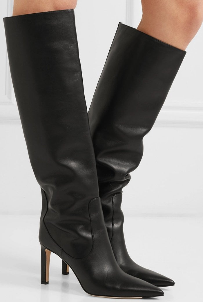 Skillfully crafted from smooth black leather, they're over-the-knee silhouette looks great worn over jeans during the day and under a cool skirt