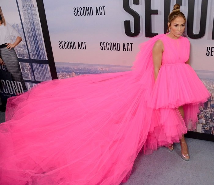 Jennifer Lopez flaunted her legs in a bright pink high-low dress from the Giambattista Valli Fall 2018 Couture Collection