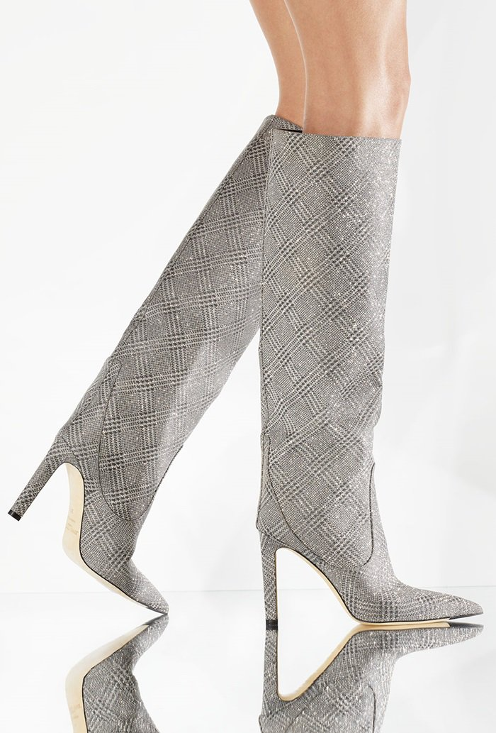 Tiny stars pattern the plaid of a knee-high leather boot that shimmers and sparkles with every step you take