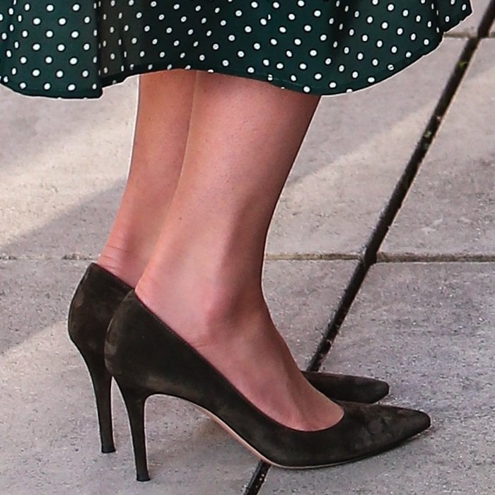 Catherine, Duchess of Cambridge (aka Kate Middleton) flaunts her legs in olive suede pumps from Gianvito Rossi