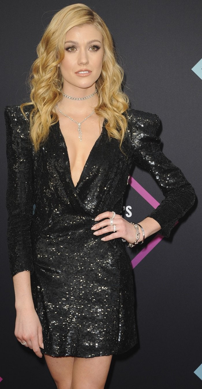 Katherine McNamara shows off two necklaces with round brilliant diamonds in platinum