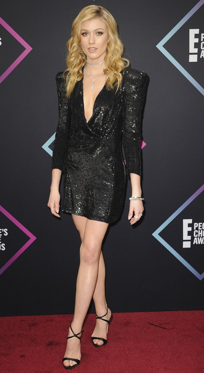 Katherine McNamara flaunted her toned pins in a Balmain Fall 2009 Paillette mini dress at the 2018 Peoples' Choice Awards at Barker Hangar in Santa Monica, California, on November 11, 2018