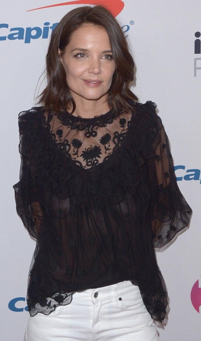 Katie Holmes wearsafeminine semi-sheer black top from Ulla Johnson