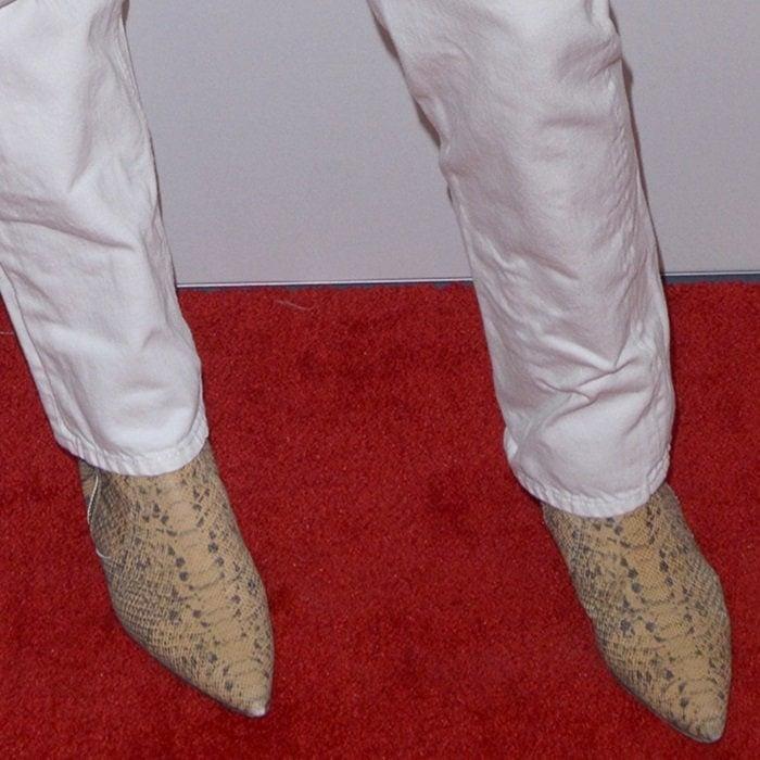 Katie Holmes hid her feet in pointy-toe snakeskin booties