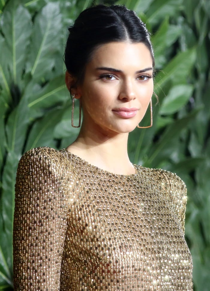Kendall Jenner styled her signature raven locks into a sleek swept back bun
