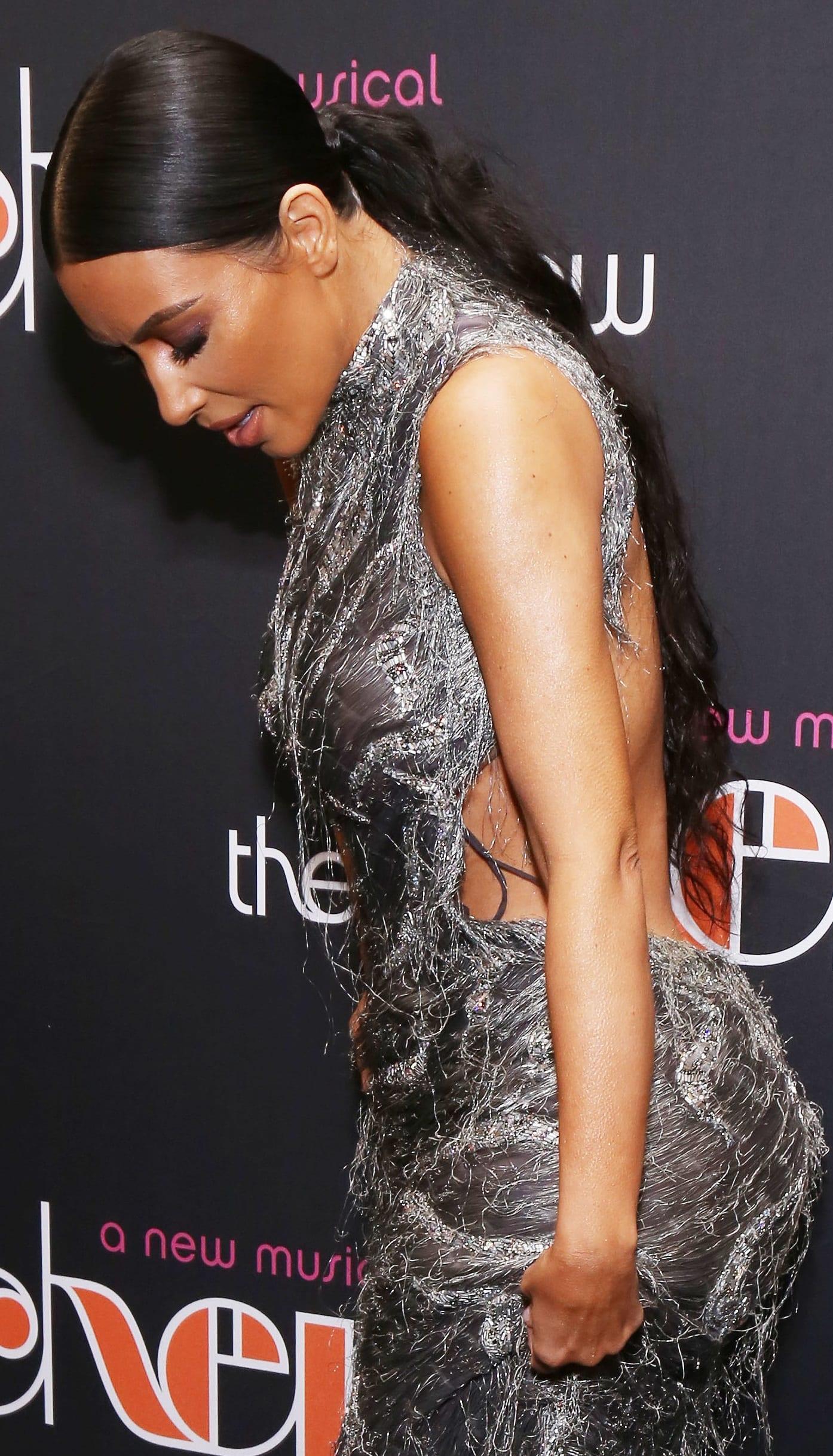 Kim Kardashian's ugly shredded dress featuresa sexy open back and a modest neckline