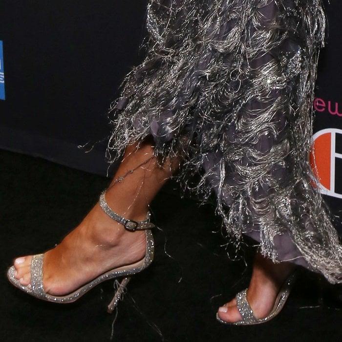 Kim Kardashian shows off her sexy feet in glittering high heels