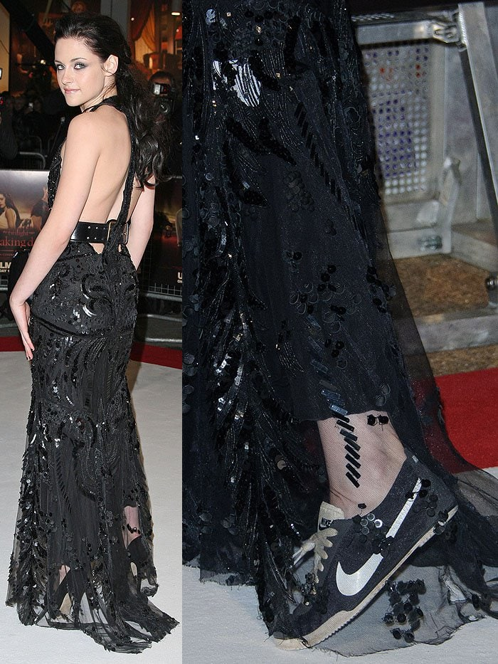 Kristen Stewart wearing dirty Nike sneakers with a Roberto Cavalli black beaded halter gown