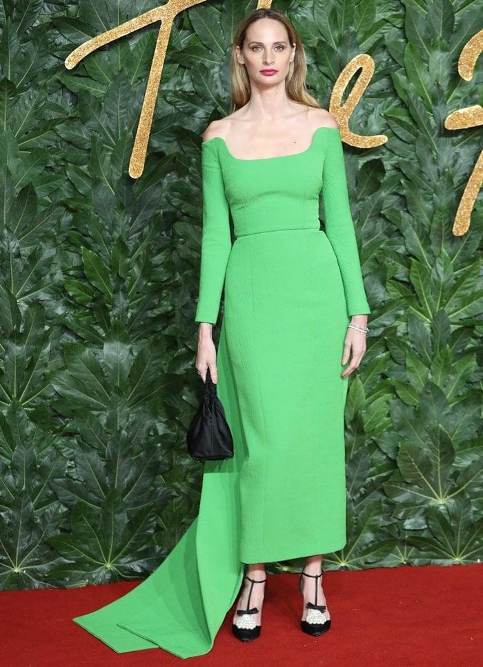 Lauren Santo Domingo styled her green dress withsatin-crepeGoyetta pumps from Christian Louboutin