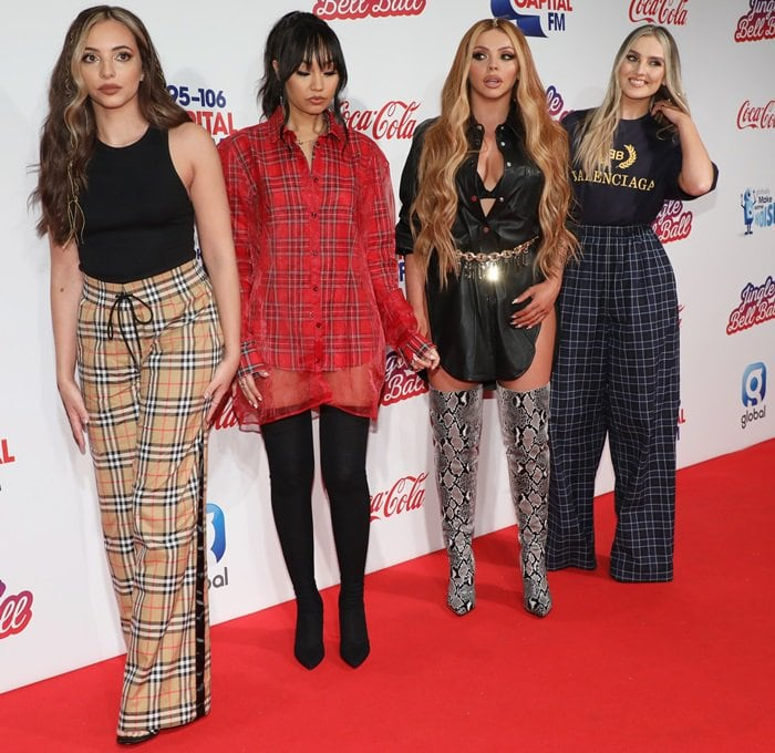 Jesy Nelson flaunted her cleavage in a sexy shirt dress paired with a gold chain Moschino belt