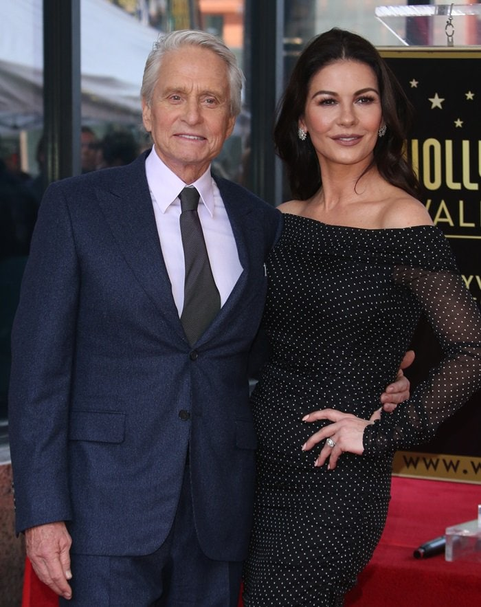 Michael Douglas posing with Catherine Zeta-Jones on the Hollywood Walk of Fame in Hollywood, California, on November 6, 2018