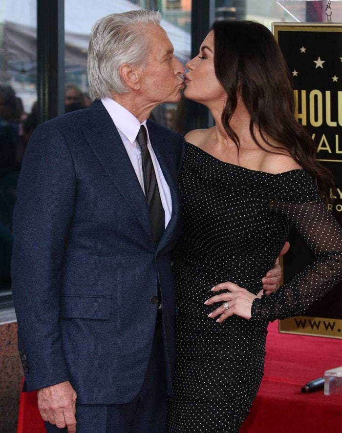 Michael Douglas kissing his wife, Catherine Zeta-Jones, who he married in 2000 after two years together