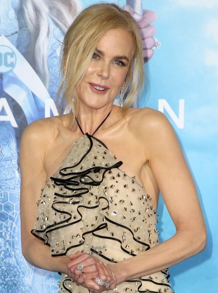 Nicole Kidman'schampagne-hued sequin-embellished halter neck tiered gown