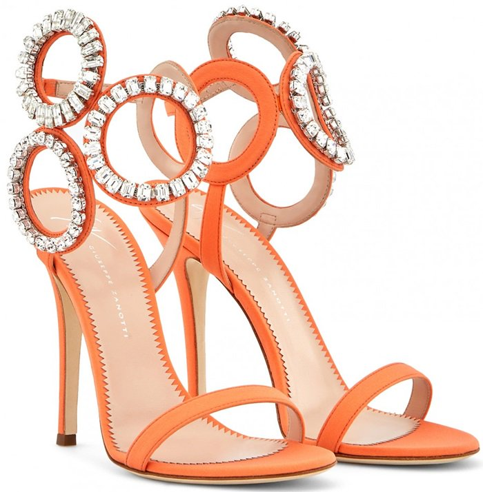 With crystal-encrusted rings, this statement sandal is a graphic beauty with style that out-maneuvers the rest
