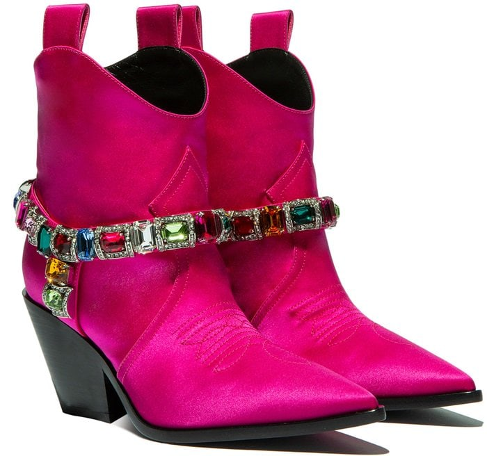 A decorative multicolor jewel adorns these metropolitan cowboy boots, creating an haute-couture street style model