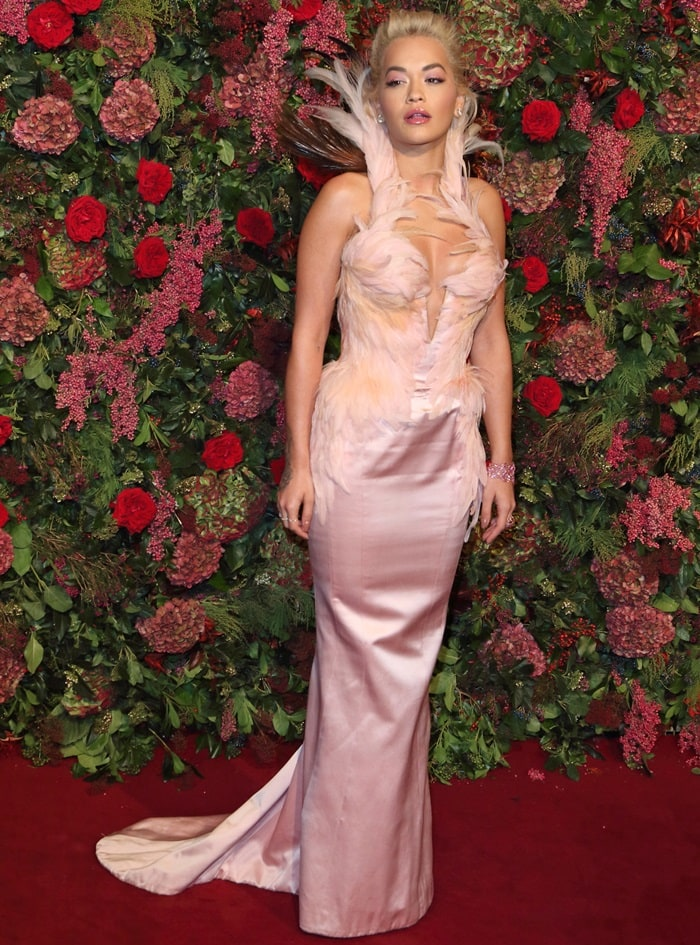 Rita Ora donned a vintage-inspired pale pink Thierry Mugler Couture gown featuring feather embellishments