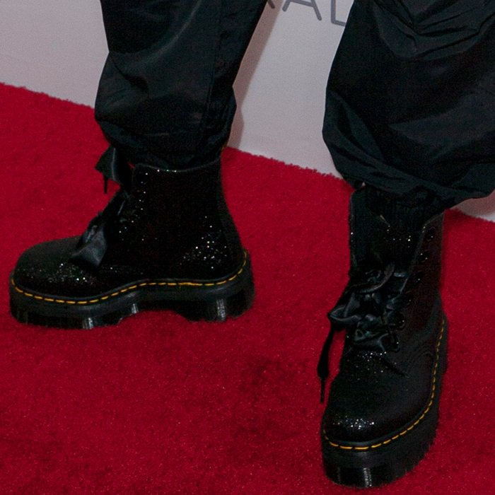 Madison Beer's boots with black sparkle glitter and extra-wide eyelets