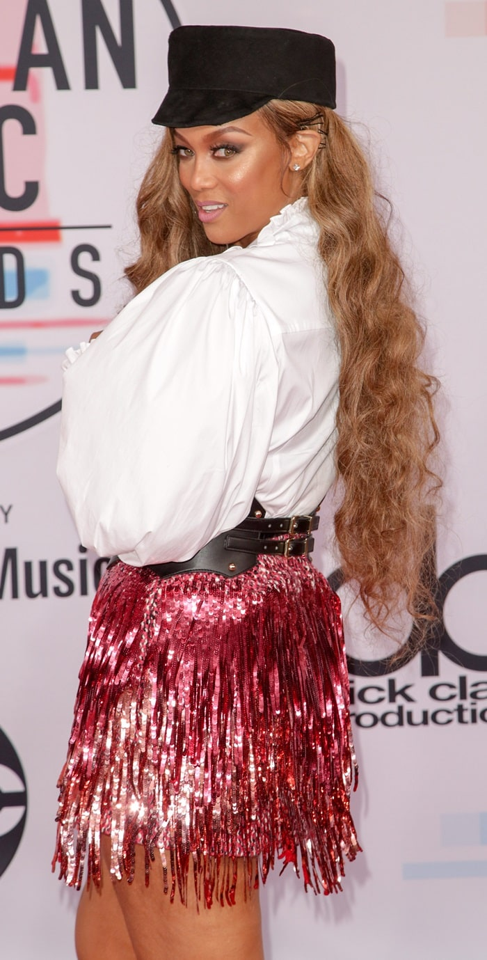 Tyra Banks rocked a whiteCaroline Constas shirt atthe 2018 American Music Awards at the Microsoft Theater in Los Angeles on October 9, 2018