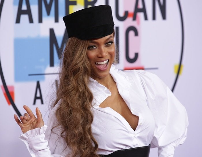 Tyra Banks wore a black train conductor hat and let her hair fall in loose waves