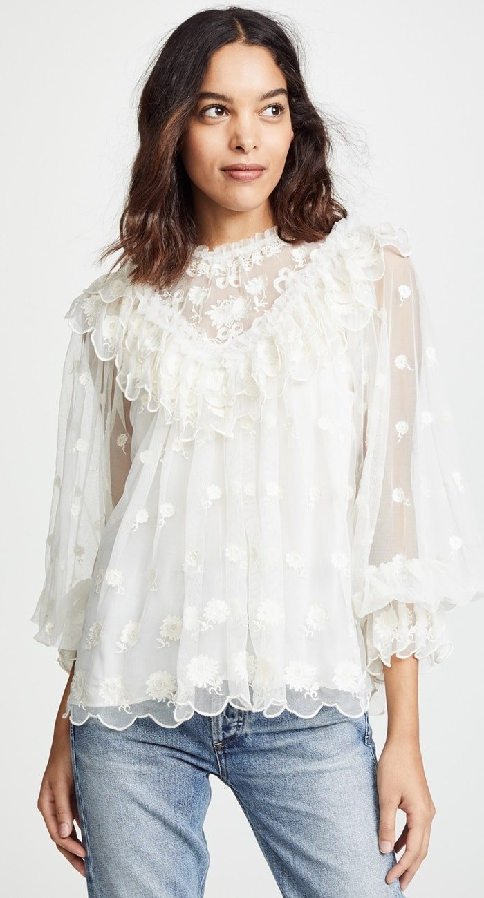 An ethereal tulle blouse decorated with embroidered blooms and frothy ruffles adds wispy romance to your day.