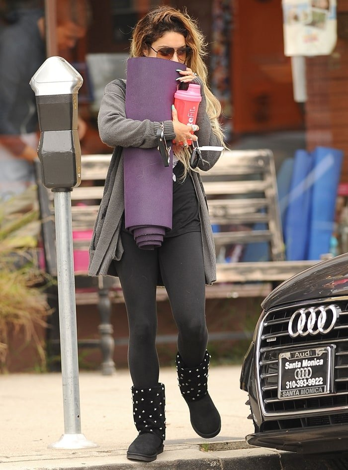Vanessa Hudgens walks out in yoga pants while hiding behind her yoga mat