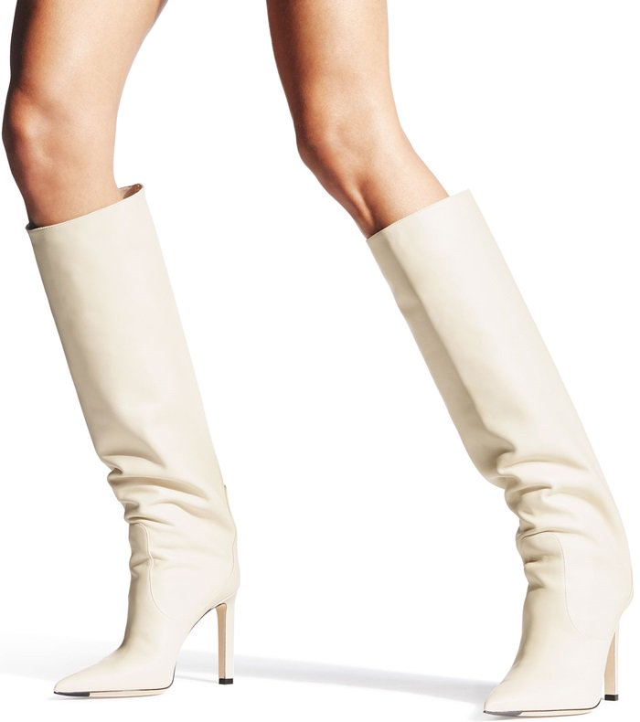 Sitting on 85mm stiletto heels and finishing with angular pointed toes, the elegant ivory-toned leather pair has been cut with a straight, wide neck for a look that you'll love for years to come