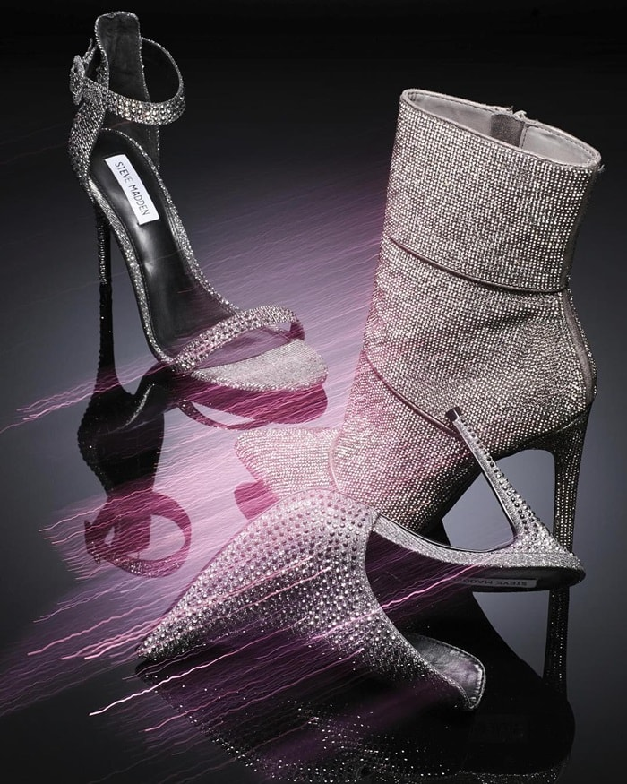Rows upon rows of tiny sparkling crystals amplify the glamour of a sleek, pointy-toe bootie lofted by a sky-high heel
